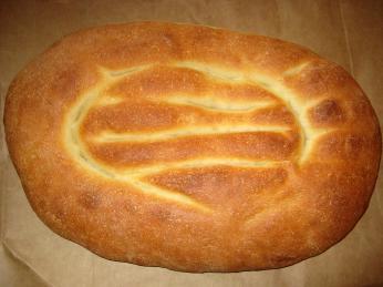 Oválný kvašený chléb vpodobě placek zvaný matnakaš