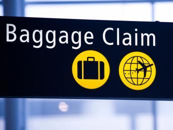 Cedule označující vyzvednutí zavazadel